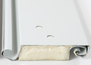 A comparison of polyurethane and polystyrene insulation for rolling doors