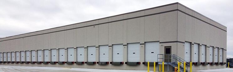 Freight terminal with hundreds of white steel roll-up doors